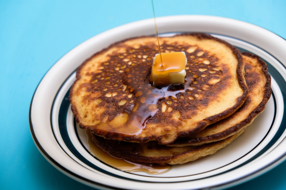 Low carb keto pancakes with sugar-free maple style syrup, and butter.